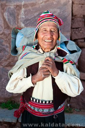 Old man in national dress on Taquile Island in Peru